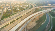 Surface Transportation News: Highways Splitting Neighborhoods, Replacing Fuel Taxes, a High-Speed Rail Proposal and More